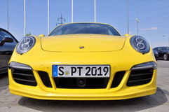 Yellow Porsche 911 Carrera 4 GTS Royalty Free Stock Images