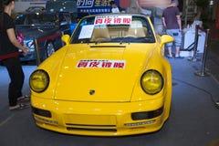 Yellow porsche coupe car Stock Photography