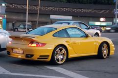 Yellow Porsche on the streets of Moscow evening Stock Photography