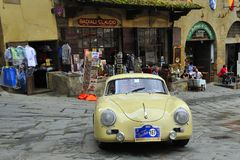 A yellow Porsche 356 A takes part to the GP Nuvolari classic car race on September 20, 2014 in Arezzo. The car was built in 1957 Royalty Free Stock Photos