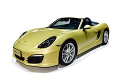 Porsche. A yellow Porsche which type is Boxster Stock Images