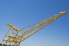 Yellow port crane. Over blue sky Stock Photography