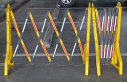 Yellow Portable Plastic Barriers Blocking The Road Stock Photos