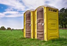 Yellow portable toilets Royalty Free Stock Photos
