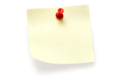 Yellow Post-it. Yellow note attached with a red pin. Isolated on a white background Stock Images