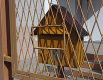 Yellow post box Stock Photography