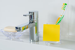 Yellow post it for copy space on the washbasin Royalty Free Stock Photography