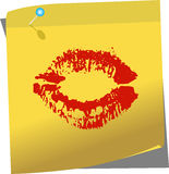 Yellow post-it with female lips Stock Photography