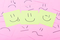 Yellow post it with happy face Royalty Free Stock Photography