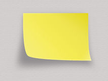 Yellow post it note. On a light background Royalty Free Stock Image