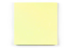 A yellow post it note. A yellow Post-it note isolated on a white background Royalty Free Stock Photos