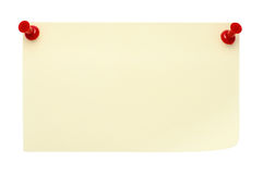 Yellow post-it note. Pinned  with two red pins,  isolated on a pure white background. Waiting for your message Royalty Free Stock Photos