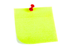 Yellow Post it Note with Red Push Pin. The yellow sheet for notes pierced the red pushpin closeup on white background Stock Photo