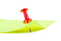 Yellow Post it Note with Red Push Pin. The yellow sheet for notes pierced the red pushpin closeup on white background Stock Image
