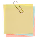 Yellow post-it note. Stack of varicoloured memos with silver paper clip on a pure white background. Waiting for your message Royalty Free Stock Images