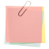 Yellow post-it note. Stack of varicoloured memos with silver paper clip on a pure white background. Waiting for your message Stock Photography