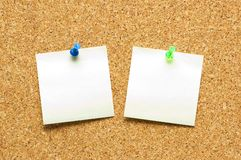 Yellow post it notes. On the corkboard Stock Image
