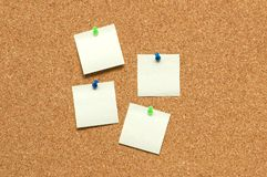 Yellow post it notes. On the corkboard Stock Photo