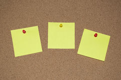 Yellow Post it Notes on a Cork Board Stock Image