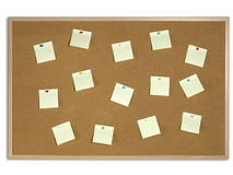 Yellow Post It Notes tacked on Cork Board Stock Photos