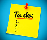 Yellow post it with a to do list written on it Royalty Free Stock Photo