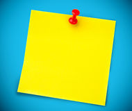 Yellow post it on the wall Stock Photography