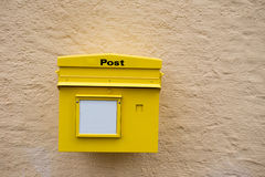 Yellow postbox on the wall Stock Photos
