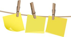Yellow postit note on a peg on string. Blank yellow postit note on a wooden peg on string against a white background Stock Photo