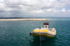 A yellow powerboat in the port of Katakolon in Greece. A boat in the port of Katakolon in Greece in a sunny day Royalty Free Stock Photography