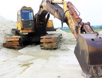 Yellow powerful excavator on a sandy quarry Royalty Free Stock Photography