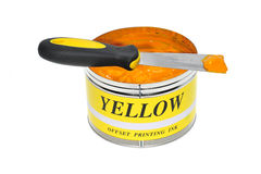 Yellow Printing Ink. Can Of Yellow Color Offset Printing Ink With Ink Knife royalty free stock photography