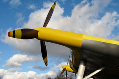 Yellow propeller airplane. Close up view of a yellow propeller airplane royalty free stock photography