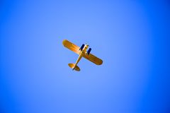 Yellow Propeller Plane in the Sky Royalty Free Stock Photos
