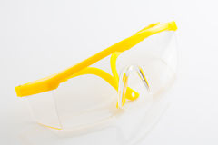 Yellow protective spectacles  isolated on white background Stock Images