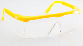 Yellow protective spectacles  isolated on white background Royalty Free Stock Images