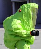Yellow protective suit to work in presence of asbestos Royalty Free Stock Images