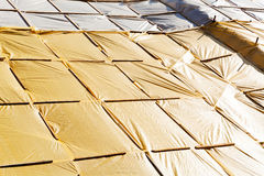 Yellow protective tarpaulins. In construction Stock Image
