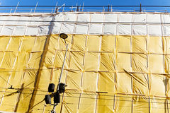 Yellow protective tarpaulins Stock Photography