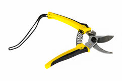 Yellow pruning shears. Isolated on white background Royalty Free Stock Images