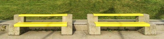 Yellow public bench Royalty Free Stock Photo