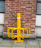 Yellow public bicycle storage. Parking point for bicycles in city Royalty Free Stock Photos