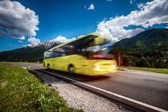 Yellow Public bus traveling on the road Royalty Free Stock Images