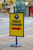 Yellow public parking sign. Sign for public parking lot in downtown Seattle, Washington Royalty Free Stock Image