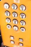 Yellow public pay phone keypad Royalty Free Stock Photography