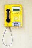 Yellow public telephone Stock Image