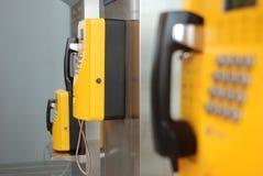 Yellow public telephone Stock Photos