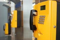 Yellow public telephone Stock Photography
