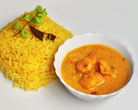 Yellow pulao and Prawn malai curry with coconut milk Stock Images