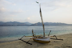 Yellow pump boat and view of Lombok island Stock Images