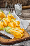 Yellow pumpkin flowers,as an element of meals Stock Image